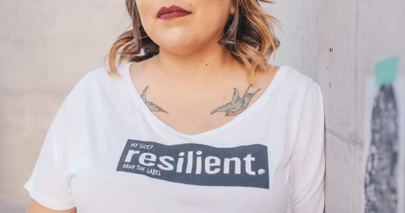 Woman wearing a shirt saying resilient